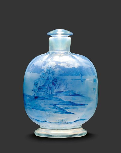 "EMILE GALLE SMALL BOTTLE ""Claire de lune"", circa 1890 Enamelled light blue glass decorated with a landscape. Signed E. Gallé Nancy. H. 9.5 cm."