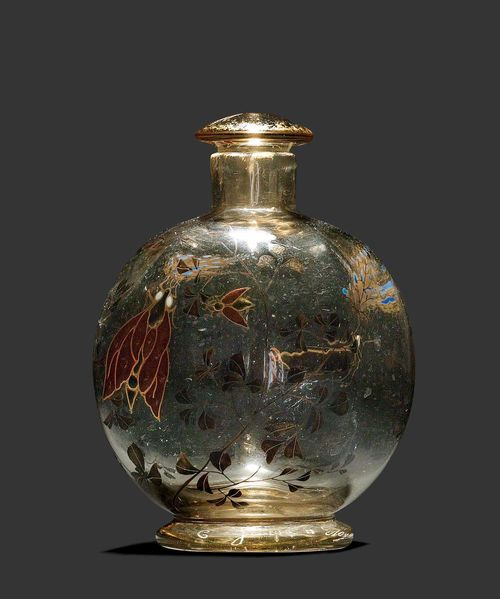EMILE GALLE SMALL BOTTLE, circa 1880 Enamelled beige glass decorated with tendrils and butterfly. Signed E. Gallé à Nancy. H. 10 cm.
