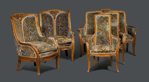 LOUIS MAJORELLE (1858-1943) SUITE OF FURNITURE, circa 1900 French walnut, carved. Comprising: 1 two-seat sofa, 2 large bergères, 2 small fauteuils and 2 chairs. All furniture items finely carved with pine branches and cones. Velour cover. Two-seat sofa: H 110 cm. L 140 cm. D 60 cm. Large bergères: 110x80x70 cm. Fauteuils: 110x70x60 cm. Chairs: 100x42x37 cm. Literature: Majorelle, Une Aventure Moderne, page 118. Louis Majorelle, Master of Art Nouveau design, A. Duncan, page 110. Musée de l'école de Nancy.