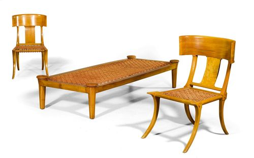 "TERENCE HAROLD ROBSJOHN-GIBBINGS (1905 - 1976) SUITE OF FURNITURE, model ""Klismos"", designed in 1937, produced by Saridis since 1965 Walnut and leather. Comprising 1 lounger and 2 chairs. Plaques on the frames. Lounger L 205 cm."