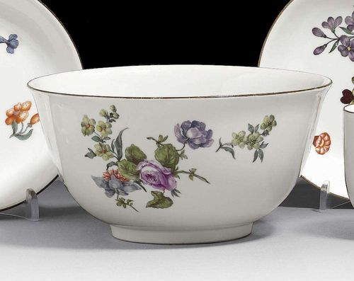 SLOP BOWL, Meissen, circa 1750. Painted with bouquets of Deutsche Blumen, rim edged in brown, crossed swords in underglaze-blue, impressed numeral, 16cm, slightly rubbed.