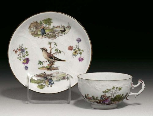 PAIR OF SMALL CUPS AND SAUCERS, Meissen, mid 18th century. With rocaille decoration in relief, painted with landscape scenes and figures between small flower bouquets and bird vignettes, rim edged in brown, crossed swords in underglaze-blue, impressed numerals.
