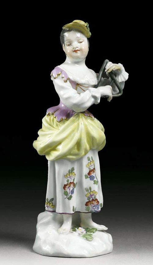 GIRL WITH TRIANGLE, Meissen, mid 18th century. Model in the manner of J.J.Kändler. Standing with a triangle in her left hand, crossed swords in underglaze-blue, impressed numeral 2, 13,3cm, small restorations.