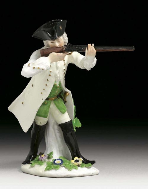 HUNTER HOLDING A GUN, Meissen, circa 1744. Standing against a tree-trunk, with his gun holding against his shoulder, crossed swords in underglaze-blue, 16cm, restored.