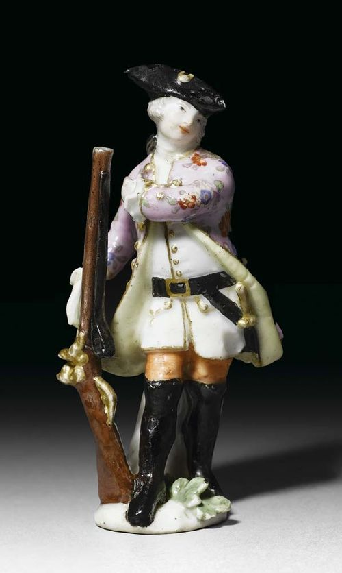 MINIATURE FIGURE OF A HUNTER, Meissen, circa 1755. Model probably by J.J. Kändler or P. Reinicke, traces of crossed swords in underglaze-blue, H 7.8 cm, heavily restored and damaged. Provenance: Private collection, West Switzerland.