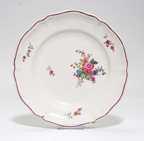 FAIENCE PLATE DECORATED WITH FLOWERS,