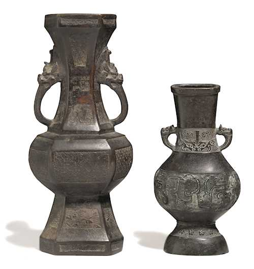 TWO ARCHAISTIC BRONZE HU-VASES WITH MAKARA-HEAD HANDLES.