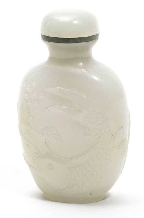 AN OVOID WHITE JADE SNUFF BOTTLE CARVED WITH A CARP.