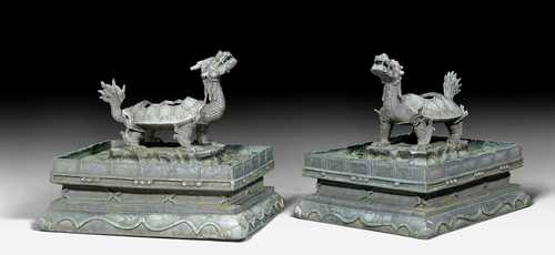A FINE PAIR OF IMPERIAL BRONZE CENSERS IN THE SHAPE OF DRAGON-TURTLES (BIXI).