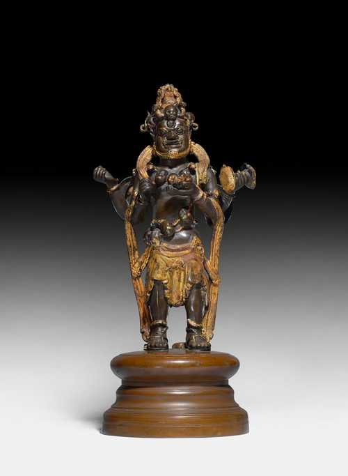 A PARTLY LACQUER-GILT BRONZE FIGURE OF THE FOUR ARMED MAHAKALA.
