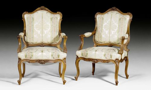 "PAIR OF FAUTEUILS ""A LA REINE"", Louis XV style, Paris, late 19th century. Shaped and carved walnut. Polychrome silk cover with flowers and leaves. 60x52x41x102 cm."