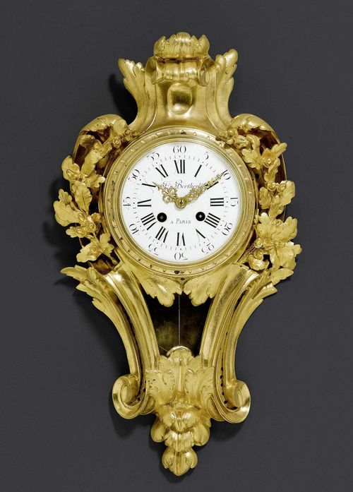 CARTEL CLOCK,Louis XV style, the dial inscribed FRD BERTHOUD A PARIS (Ferdinand Berthoud, 1727-1807), Paris, late 19th century. Matte and polished gilt bronze. Enamel dial and 2 fine gilt hands. Paris escapement striking the 1/2 hours on bell. Pendulum viewing window. Some servicing required. Glass with defect. H 46 cm, W 25 cm.