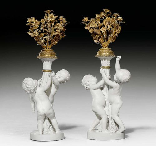 PAIR OF LARGE CANDELABRA WITH BISCUIT FIGURES,Louis XVI style, Paris, late 19th century. Biscuit and parcel gilt bronze. Each with 7 nozzles. Some chips. 4 nozzles missing. H 120 cm.