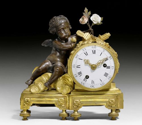 "MANTEL CLOCK ""A L'AMOUR"",Louis XVI style, Paris, 19th century. Gilt and burnished bronze. Amor with 2 small porcelain flowers. Enamel dial with 2 fine gilt hands. Paris escapement striking the 1/2 hours on bell. 26x9x26 cm."