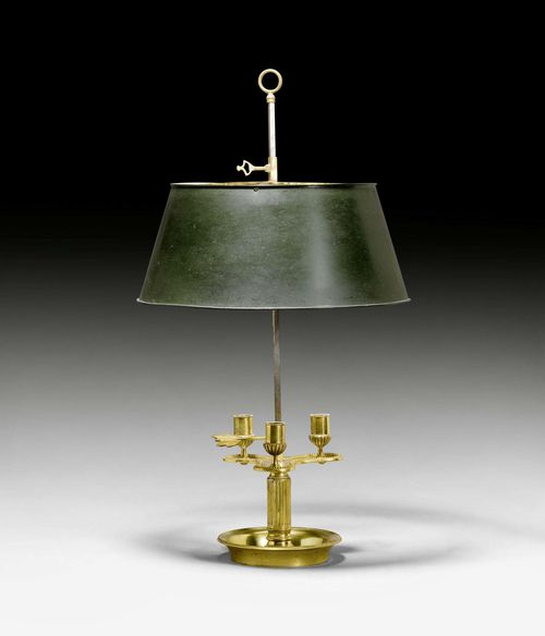 BOUILLOTTE LAMP,Louis XVI style, Paris, late 19th century. Bronze and brass. Height-adjustable light holder with 3 nozzles and height-adjustable, dark painted metal shade. Fitted for electricity. H 70.5 cm.