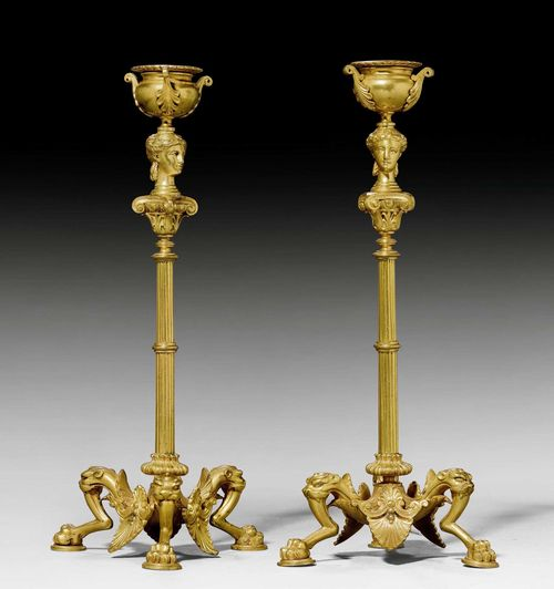 PAIR OF CANDLESTICKS,Napoleon III, France, 19th century. Fine relief-decorated gilt bronze. H 27.5 cm.