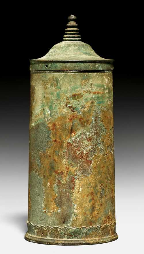 A CYLINDRICAL BRONZE SUTRA CONTAINER.