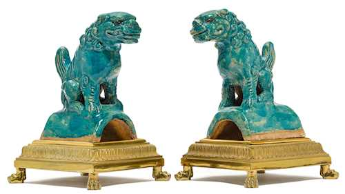 PAIR OF FOO DOGS ON A BRONZE MOUNT.