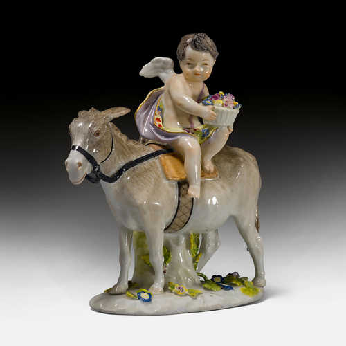 PUTTO SEATED ON A DONKEY,