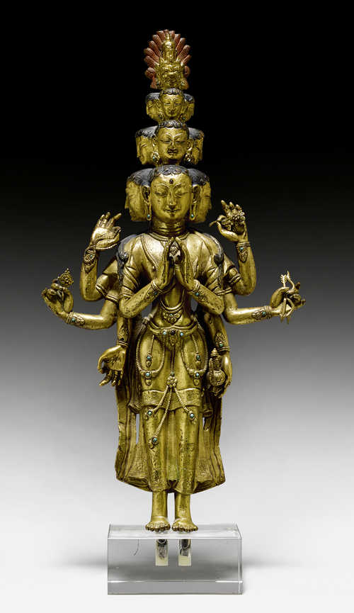 A LARGE GILT COPPER ALLOY FIGURE OF THE ELEVEN-HEADED AVALOKITESHVARA.