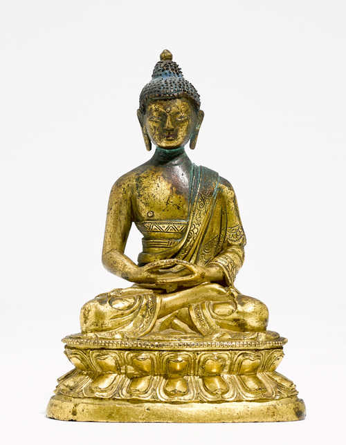 A GILT-BRONZE FIGURE OF A SEATED BUDDHA.