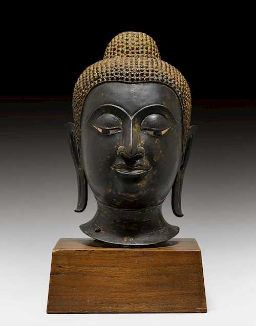 A BRONZE HEAD OF BUDDHA.