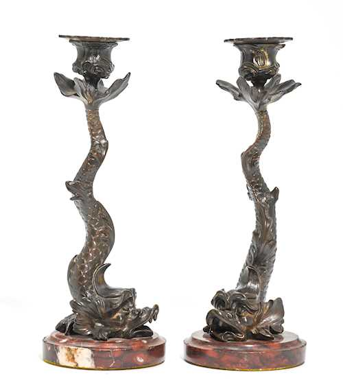 PAIR OF CANDLESTICKS DESIGNED AS DOLPHINS,