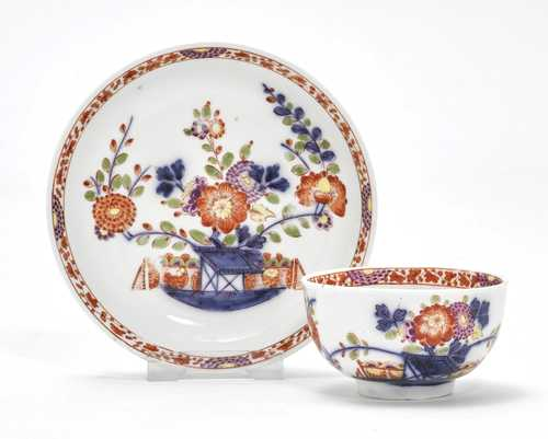 "CUP AND SAUCER WITH  ""TISCHCHENMUSTER"" DECORATION"