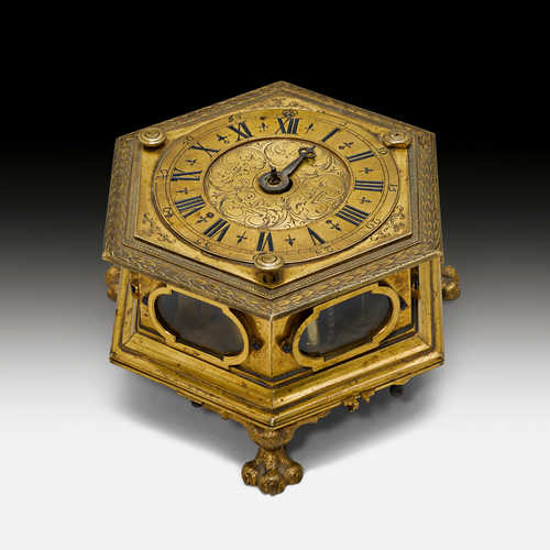 A HEXAGONAL TABLE CLOCK,