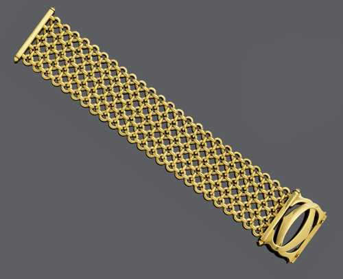 GOLD BRACELET, BY CARTIER.