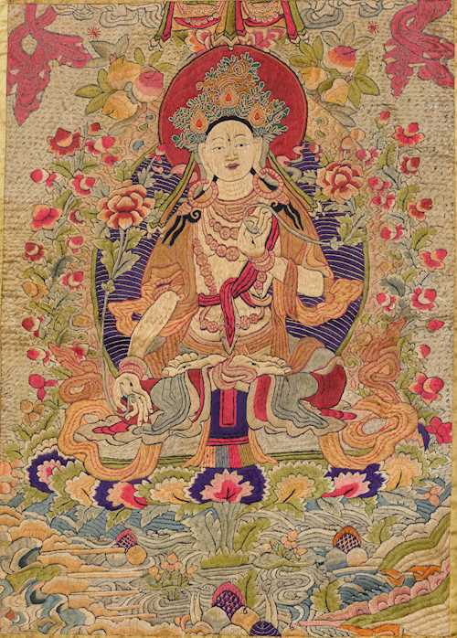 AN EMBROIDERED SILK THANGKA OF THE WHITE TARA.