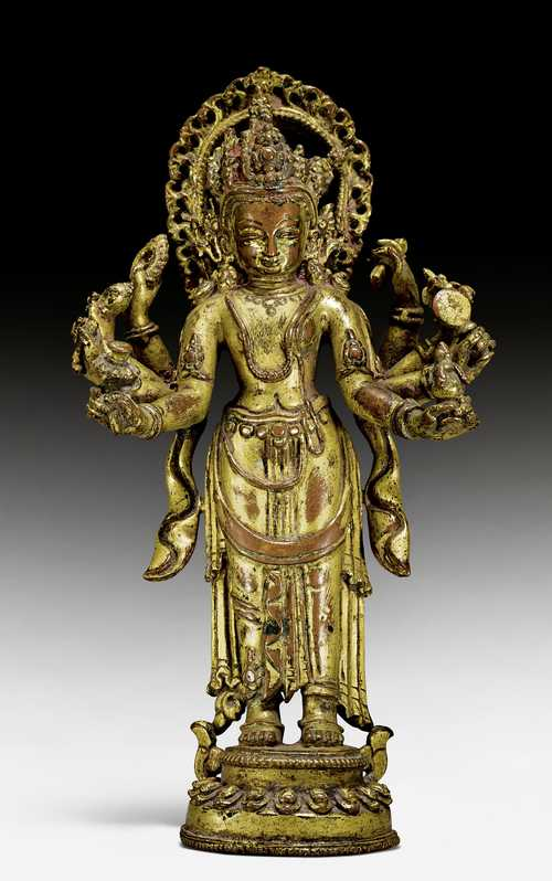 A GILT COPPER ALLOY FIGURE OF LAKSHMI-NARAYANA.