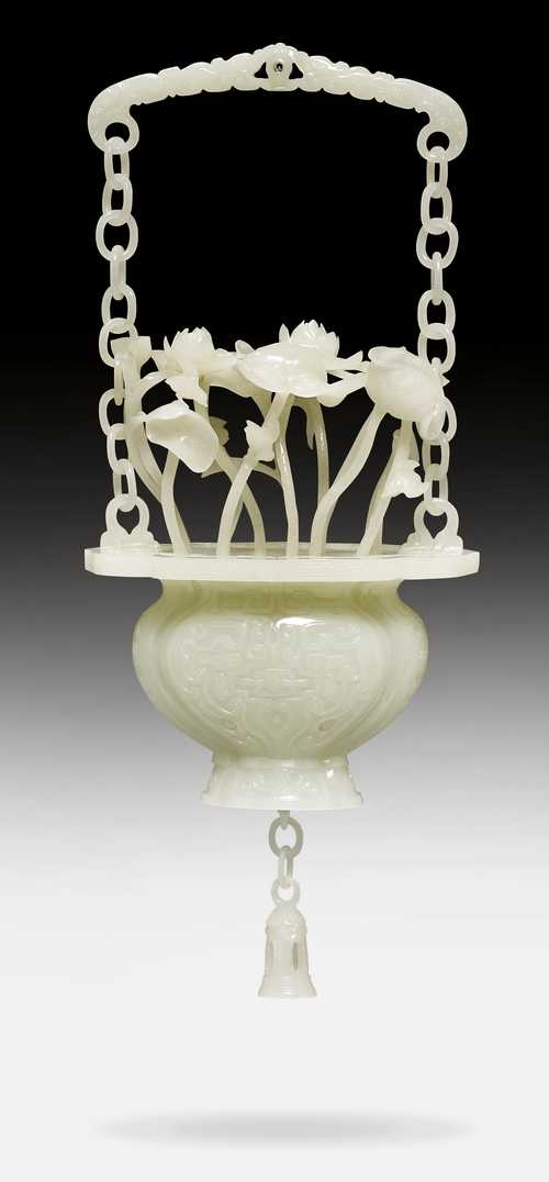 AN EXQUISITE WHITE JADE CARVING OF A HANGING VASE WITH LOTUS.