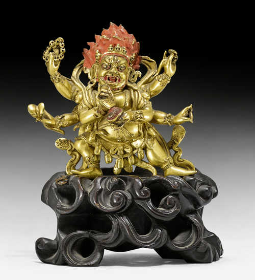 A GILT BRONZE FIGURE OF MAHAKALA.