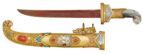 A CEREMONIAL DAGGER SET WITH JADE CARVINGS, CORALS AND TURQUOISES.