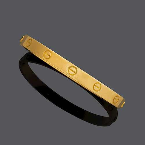 GOLD BANGLE, BY CARTIER.