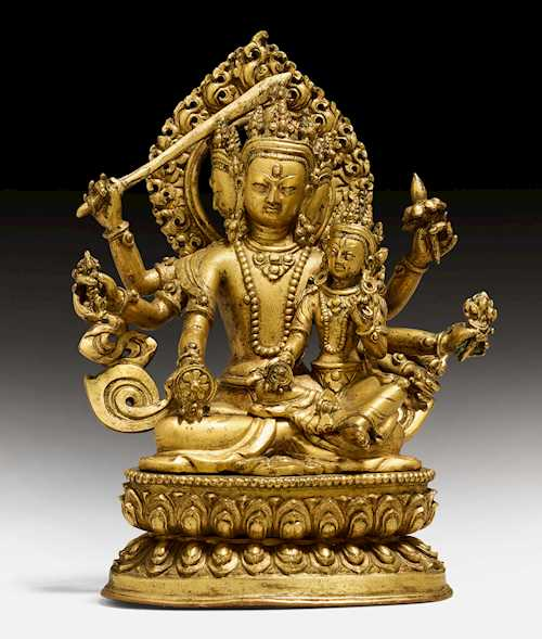 A GILT COPPER FIGURE OF MANJUSHRI WITH HIS CONSORT SARASVATI.