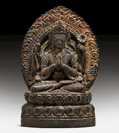 A FINE ZITAN WOOD CARVING OF AVALOKITESHVARA SHADAKSHARI.