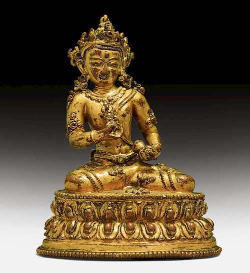 A CHARMING GILT COPPER ALLOY FIGURE OF VAJRASATTVA.