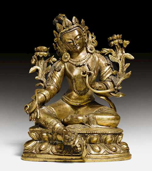 A GILT BRONZE FIGURE OF THE GREEN TARA.