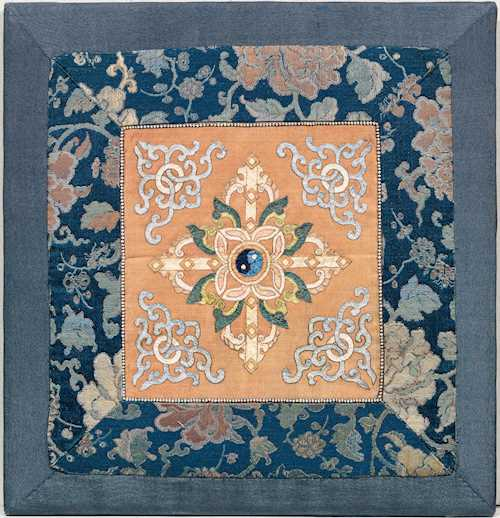 A SILK APPLIQUÉ TEMPLE TEXTILE.