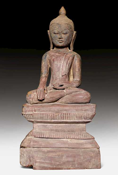 A WOODEN FIGURE OF THE SEATED BUDDHA, THE HANDS IN THE EARTH-TOUCHING MUDRA.
