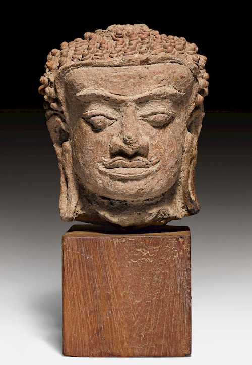 A TERRACOTTA HEAD OF BUDDHA.