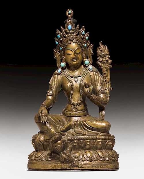 A BRONZE FIGURE OF THE GREEN TARA.