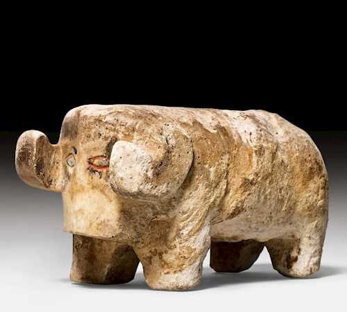 A WHITE CALCITE SCULPTURE OF A RAM.