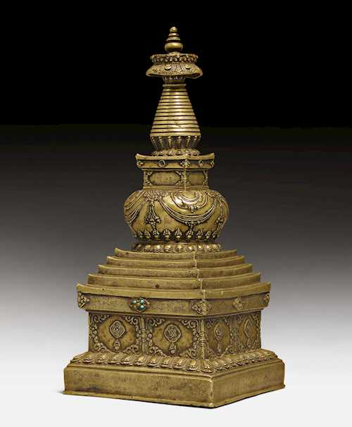 A RARE BRONZE STUPA ADORNED WITH FINE ENGRAVINGS.