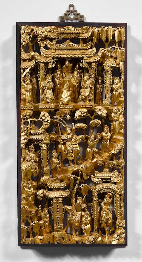 A DECORATIVE CARVED PANEL.