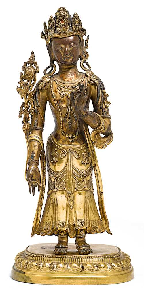 A GILT COPPER REPOUSSE FIGURE OF A STANDING BODHISATTVA.