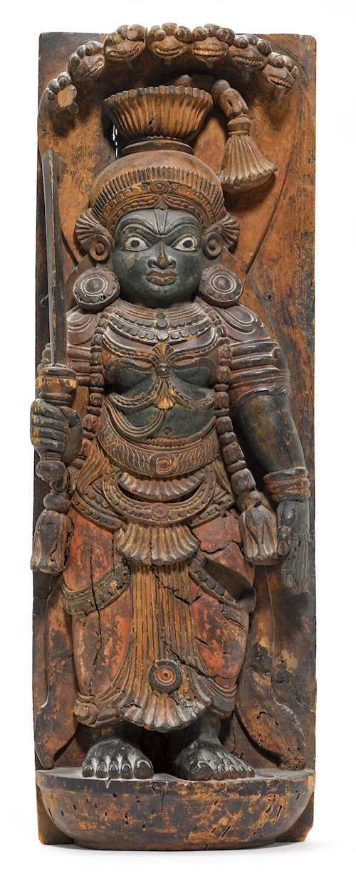 A POLYCHROMED WOODEN STELE OF A GUARDIAN.