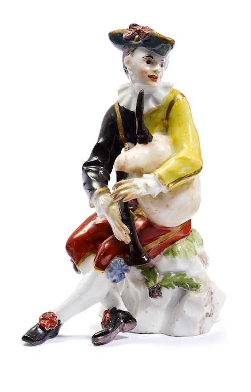 A HARLEQUIN WITH BAGPIPES